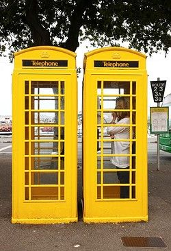 Yellow phone boxes on Guernsey, Channel Islands