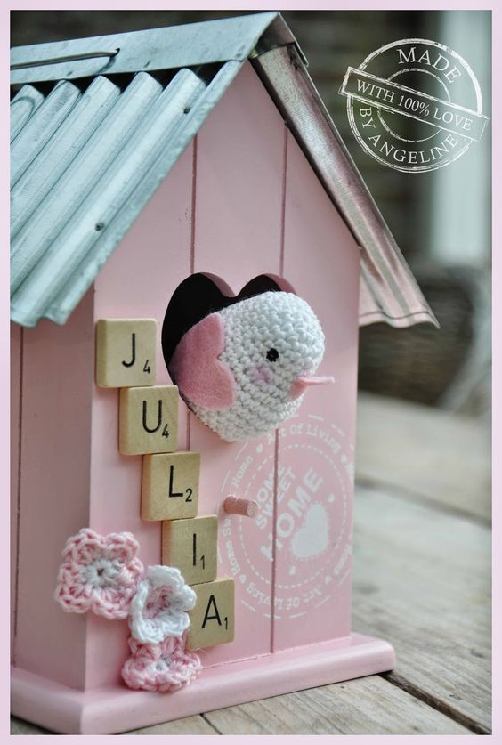 crocheted bird in a birdshouse with link to bird pattern(free)