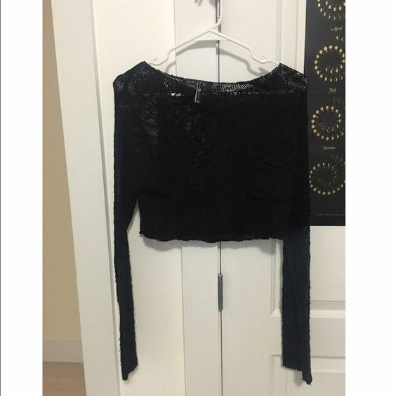 shredded black crop sweater Beautiful black sweater with shred detailing ~ pocket on the front and cropped ~ super cute with a skirt  ~ Kill City brand from urban outfitters Urban Outfitters Sweaters
