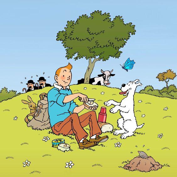 野原でピクニックを楽しむタンタンの画像