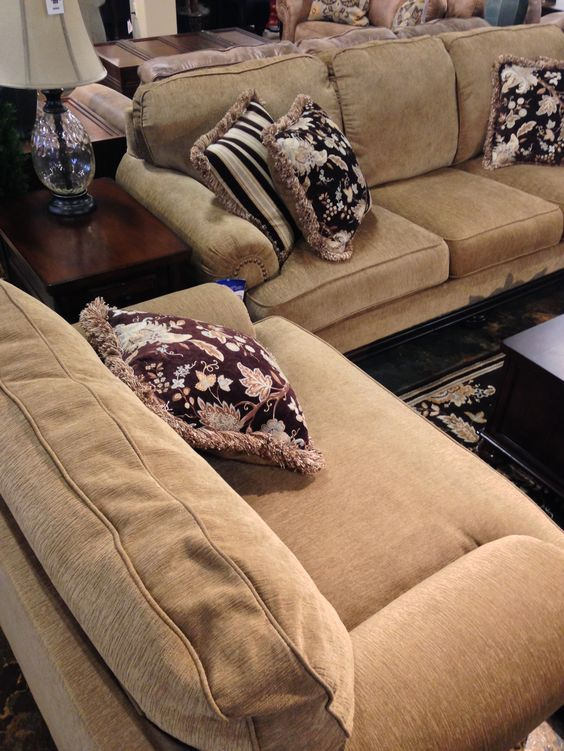 "Flowing with rich traditional beauty, the ""Porters Gate-Umber"" upholstery collection features plush rolled arms and seating cushions all perfectly adorned with the deep finished showood to create a sophisticated atmosphere within any living area. 