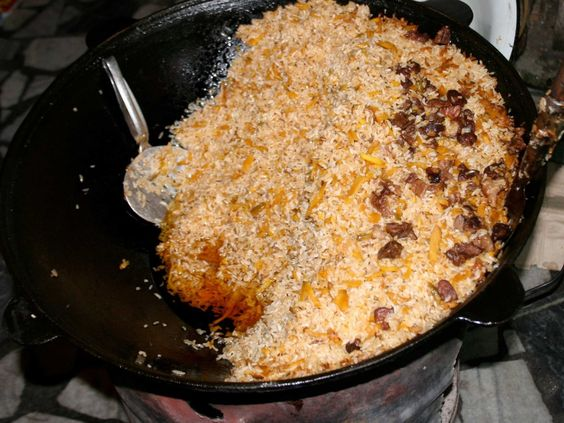 Palov (plov or pilaf) is a popular rice dish in Uzbekistan made of meat, onion, carrots, rice and variations including chickpeas and raisins. It's usually served on a large plate for sharing.