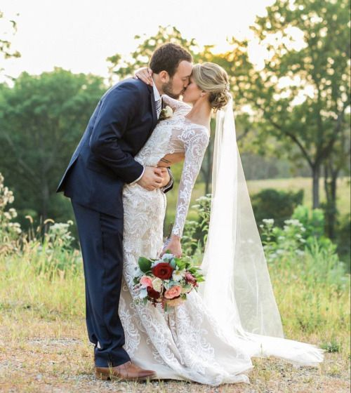 Lace longsleeved wedding dress. Wedding photo ideas! Ideas for your wedding.. Love the long veil and boho flowers. Boho Wedding.: