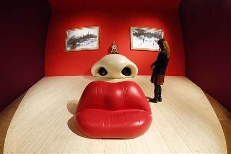 A visitor looks at the Rita Mae West room by Spanish artist Salvador Dali (1904-1989) during a press visit of the exhibition 'Dali' at the Centre Pompidou modern art museum, also known as Beaubourg, in Paris November 19, 2012. REUTERS-Benoit Tessier
