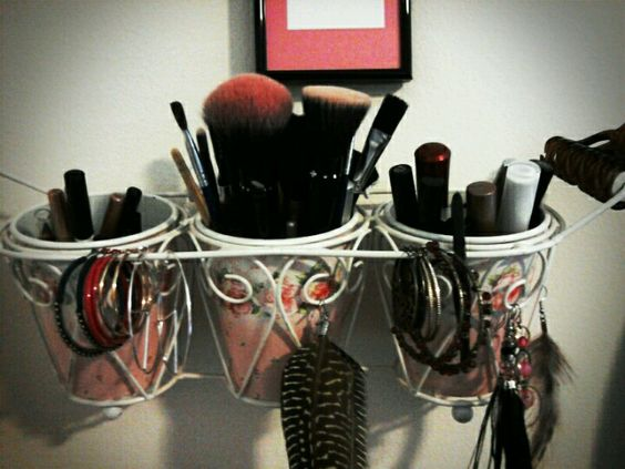 Use a cute and decrotive plant pot in a holder to keep eye liner mascara nake up brushes etc. To keep your stuff nice and handy! I keep some of my longer earings on there too! You can just. Have it sitting on your desk or counter or take some little screw in hooks to hang it on the wall! I love how this works for me!