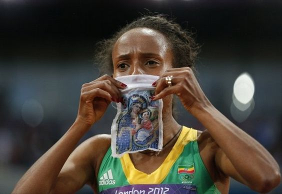 Meseret Defar 5000 meter race to win the gold. How awesome is it that she has our Lords Mother Mary with her. Love it!