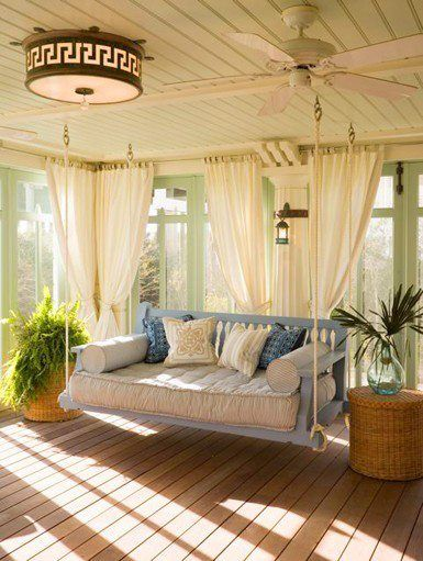 I love this big porch swing and the light paint exterior colour w/plants looks warm and inviting...a great place to lay and read a good book!