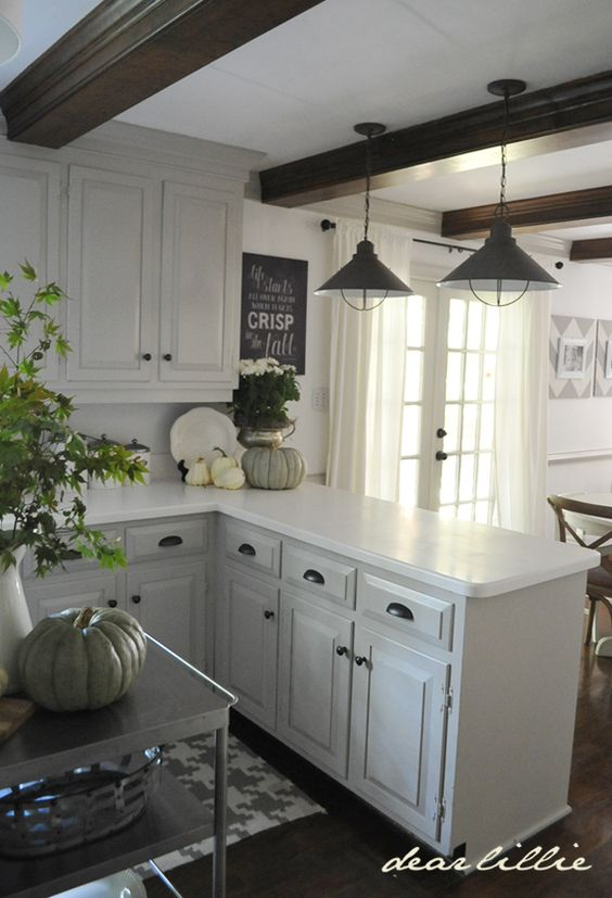 "This would be like my kitchen (minus the sealing beams) if I changed the single wide ""dutch door"" to french doors onto the patio deck. This is where we took down the overhead cabinet over the peninsula counter."