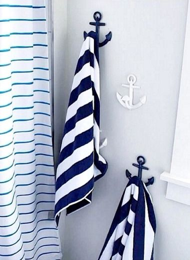Blue and White Anchor Hooks from Pottery Barn Kids: http://www.completely-coastal.com/2014/01/anchor-hooks.html They also have red anchor hooks. Hooks are made from iron and mounting hardware is included.