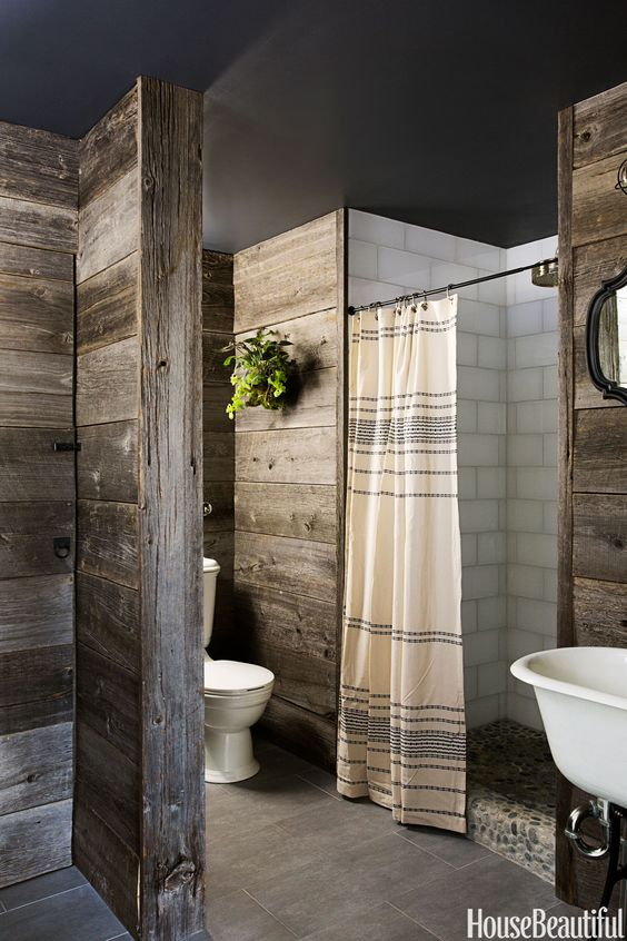 """In this country bathroom by Andrew and Yvonne Pojani, the design is all about the warm, reclaimed barn wood on the walls. """"It's natural, rustic. Kind of inside out, as if you had put the exterior on the interior,"""" Yvonne Pojani says. Pin it »   - HouseBeautiful.com"""