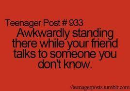 lookking around.. and pretending to text someone.. yep.
