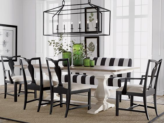Decor in black and white, with trestle table, striped bench, and green bottle accents. Buckhead.
