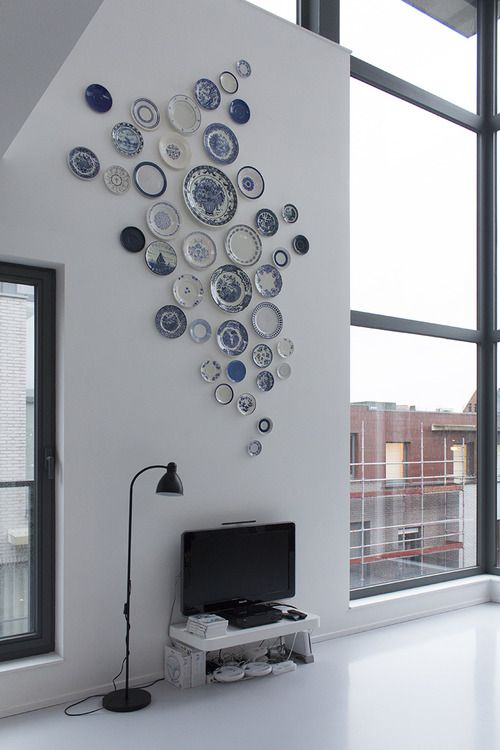 Love the juxtaposition with a modern room.  FROM: Plates on wall by www.talloor.com