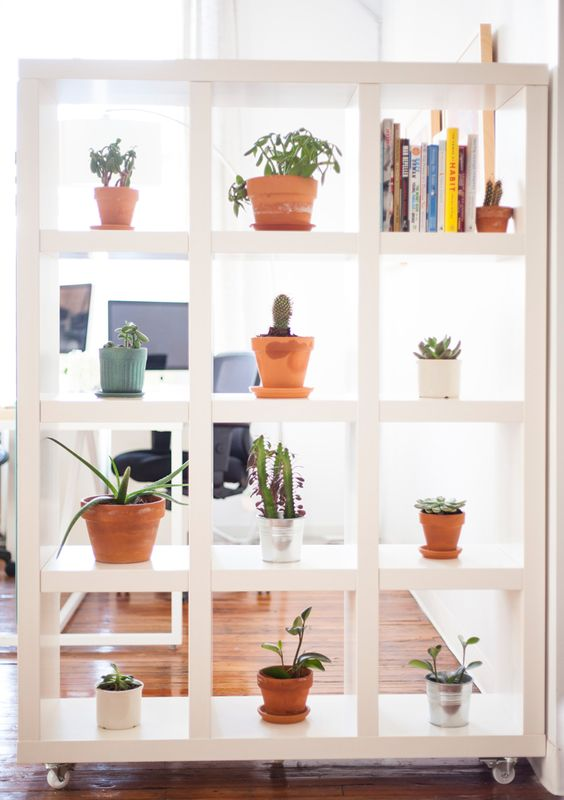 shelving with wheels makes a great room divider / before  after on the west elm's blog: