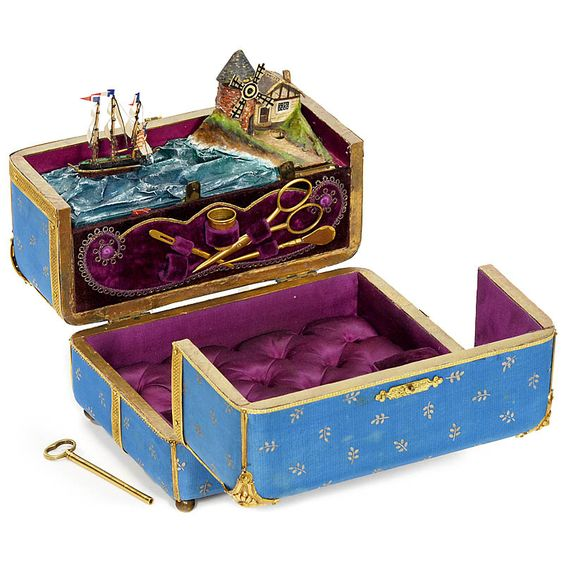 This is a rare French musical Sewing Necessaire Automaton of around 1890. It has a key-wind two-air cylinder movement driving windmill sails and a rocking ship on stormy sea