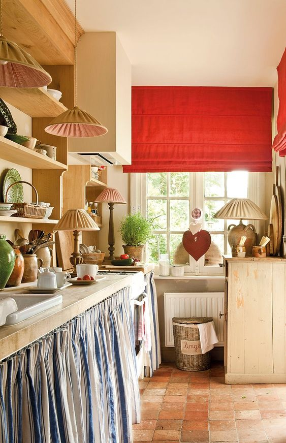 Charming Belgian style kitchen with skirted sink and red accents. #kitchen #belgian #red #rustic #country