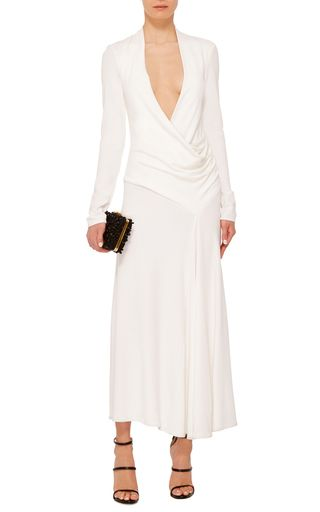 This **Cushnie et Ochs** dress features a sheath silhouette and a draped bodice.