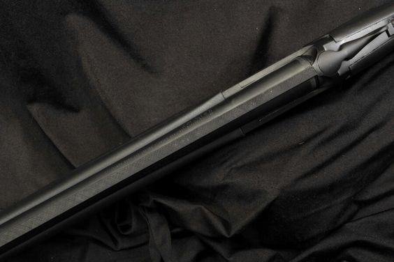 MY MOSSBERG MAVERICK 12 GAUGE OVER/UNDER SHOTGUN