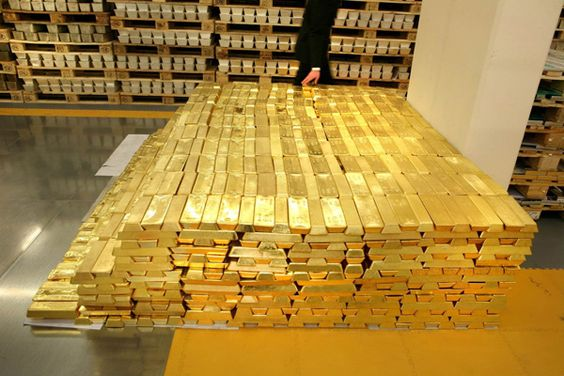 Swiss Bank Gold Bars - $2 Billion of Gold.  Think about it... this stack of yellow metal is worth as much as an entire community of 2,000 one-million-dollar luxury estate houses.