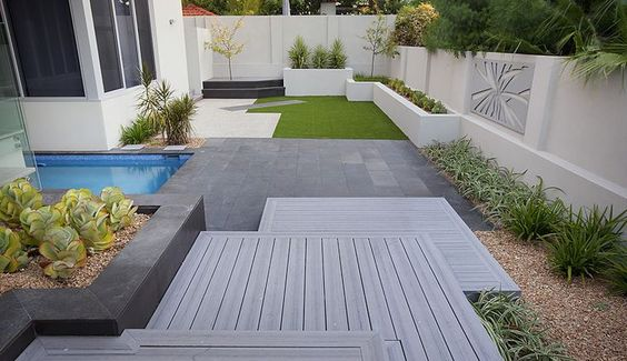 Rendered beds lawn decking pavers modern garden pebbles for Gardens with decking and paving