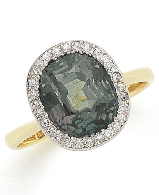An Edwardian alexandrite and diamond cluster ring, circa 1910. The cushion-shaped alexandrite, weighing 5.09 carats, within a surround of single-cut diamonds, mounted in gold and platinum. #Edwardian #ring