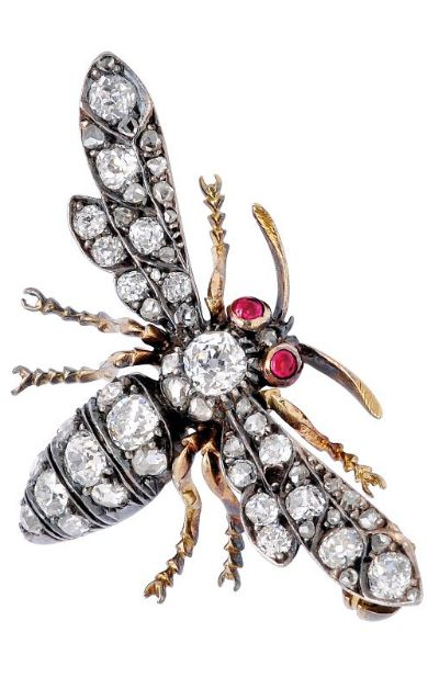 An Antique Diamond Bee Brooch  Designed as a stylised bee with old mine and rose-cut diamond body and wings, tiny ruby eyes, mounted in silver and 18k gold, late 19th century