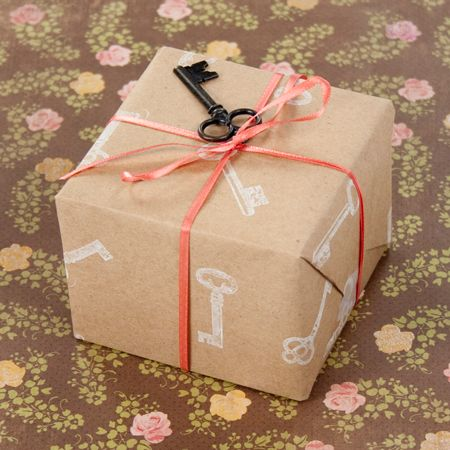 Kraft gift wrap with ribbon and tied key