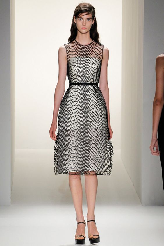I am a little bit disappointed by this Calvin Klein collection, although this dress is frickin' amazing. Click for more.