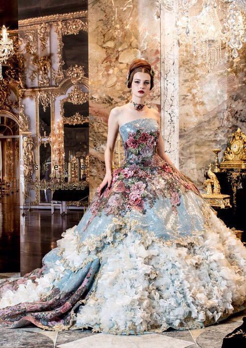 wow gown, its fabulous but then the other half me is like pondering life asking where would you wear this besides a model for a photo shoot lol simply stunning though!!
