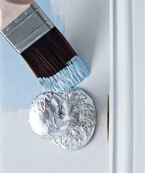 Foil-covered doorknob protected against paint Protect doorknobs and hardware in the kitchen and bathroom when you're painting by wrapping foil around them to catch dribbles. The foil molds to the shape of whatever it's covering and stays firmly in place until the job is complete.