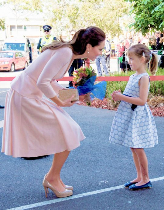 Catherine, Duchess of Cambridge receives flowers from spectators at the Playford Civic Centre on April 23, 2014 in Adelaide, Australia.: