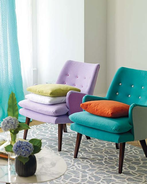 Lilac, petrol blue, orange, lime and white. Great colour scheme... And love the retro chairs.: