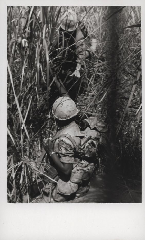 "Marine Lends a Helping Hand, 1969 ""Lending a Hand: An outstretched hand from a Marine buddy helps lift this Leatherneck from a deep stream south of the Demilitarized Zone. The 9th Marine Regiment Leathernecks were participating in Operation Dawson River, west of Khe Sanh in the northernmost province of South Vietnam (official USMC photo by Lance Corporal Don Barr)."" From the Jonathan Abel Collection (COLL/3611), Marine Corps Archives & Special Collections. OFFICIAL USMC PHOTOGRAPH"
