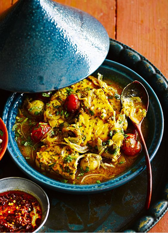 Chermoula tomato and fish tagine: an easy and quick tagine made for sharing. It's full of flavour but doesn't need hours in the pot. Giant couscous and harissa give it texture and heat and the preserved lemon makes it more authentic. Serve to a crowd at a party or as a dinner-party main course