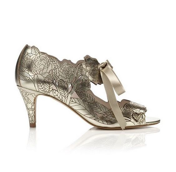 Peony low gold, a mid-heel sandal with leather that has been crafted with an intricate floral laser design. Made in Spain, the style fastens neatly on the foot and comes with both a silk ribbon and a leather lace. In stock and available to buy online with worldwide shipping #harrietwilde #shoes #weddingshoes #shoe #goldshoes #peonyshoes #peony #shoelove #instashoes #instabride