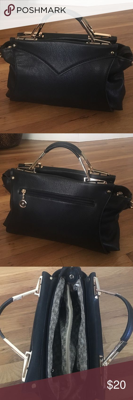 Chic Black Bag This pretty black bag with gold detail can hang on your arm or used with the detachable shoulder strap. Zip closure with pockets inside. Barely used. Excellent condition. Bags Satchels