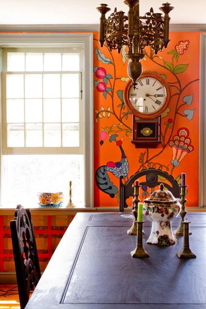 Love this!!!  Free-form murals adorns the dining room walls. Its chickens, birds, flowers, leaves, guinea hens and peacocks offer a tribute to the animal-friendly home. Below the chair rail, a plaid pattern designed with painter's tape contrasts the playful forms above.