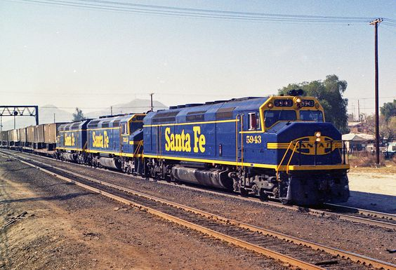 https://flic.kr/p/cP7m8s   Better Blue Than Yellow Bonnet   Santa Fe's eastbound 198 train, the Super C, is about to hammer the diamonds at Colton, CA on Sunday, Feb. 27, 1972. Repainted FP45 5943, leads an F45 and another repainted FP45 in this view shot on Ektacolor film.