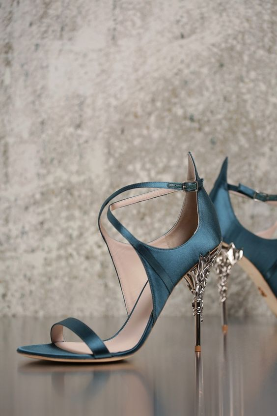 <p>The Eden Eve Pump in Black Satin and Silver Leaves is part of an exclusive preview of our new accessories collection, as featured in the AW16/17 Couture Show. For more information about the launch date and availability of this piece, please get in touch.</p>