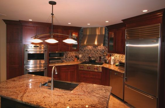 Kitchen Remodel with large island area and sink to make food preparation easy - Fein Construction
