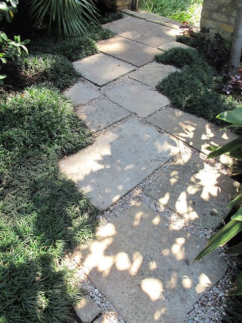Stone or concrete pavers as a garden path paths trails for Cement garden paths