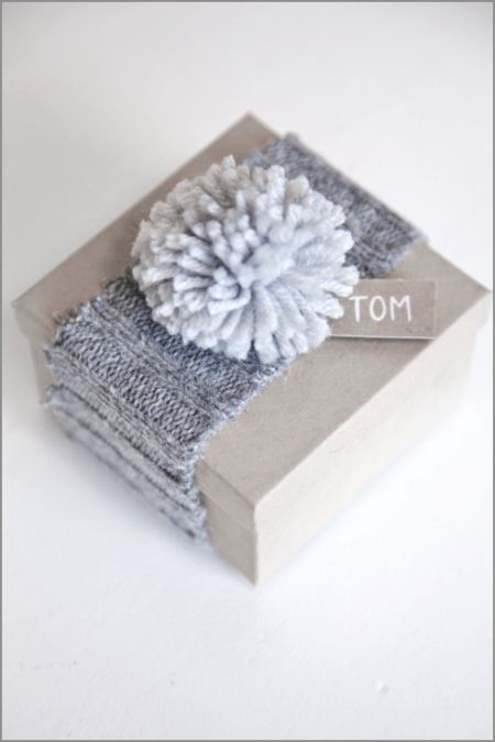 re-purposed sweater wrapping and pom