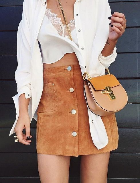 White shirt, lace bralette, suede skirt, and Chloé Drew Saddle Bag.: