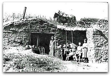 Settlers taking advantage of the 1862 Homestead Act innovate and build Dugout homes due to the lack of trees on the Plains.