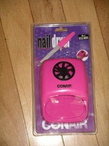 "Conair ""Beauty Essentials"" Nail Dryer by Conair. $29.99. Nails dry in minutes. Provides flawless salon finish.. Convenient side compartment holds nail polish.. Operates with 4 AA patteries (not included). Automatic pressure-activated On/Off rest stand.. Wet nails and In a hurry? Dry them quick! Going on a trip and need to keep the nails in beautiful shape? It's portable and packable. Don't want a large, expensive nail dryer? This is the one for you!"