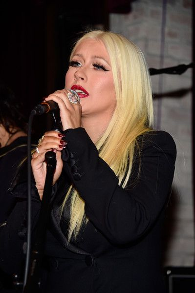 Christina Aguilera perform at the celebration for Linda Perry's song 'Hands Of Love'