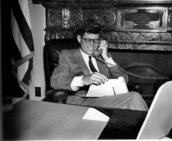 After Jack became President he didn't want to be photographed wearing glasses. But he had been wearing glasses since age 13.They were prescribed for him by Dr. John Wheeler for far-sightedness. But here he is in his Senate Office on the 21 of April 1958.: