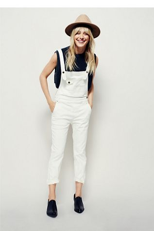 Washed Denim Overall | Distressed wash skinny denim overalls. 5-pocket style. Adjustable crisscross straps. Pocket detailing on front bib.: