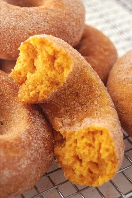 Baked Pumpkin Donuts - With their brilliant orange color, pleasingly moist texture, and delightful pumpkin flavor, these baked (not fried) doughnuts are the perfect on-the-go breakfast for a crisp autumn day