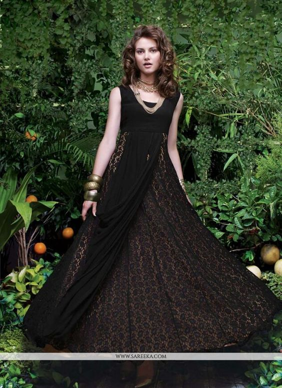 An exceptional black net designer gown will make you appear incredibly stylish and graceful. This pretty attire is showing some brilliant with embroidered and resham work. (Slight variation in color, ...